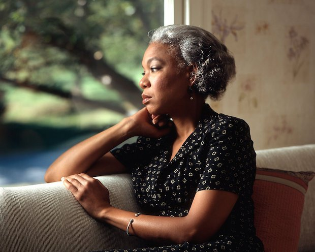 17073-an-african-american-woman-looking-out-a-window-pv